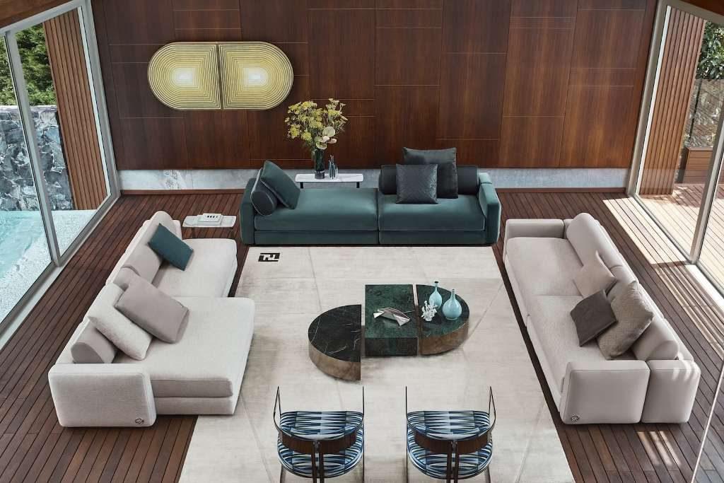 פינת הסבה הכוללת שתי ספות מודולריות באפור וספה אחת בירוק, בעיצוב פנדי קאזה